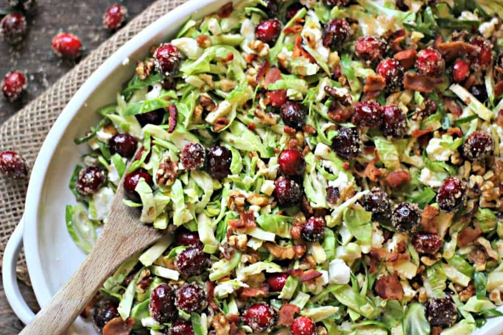 Brussels sprouts cranberry salad in a white dish