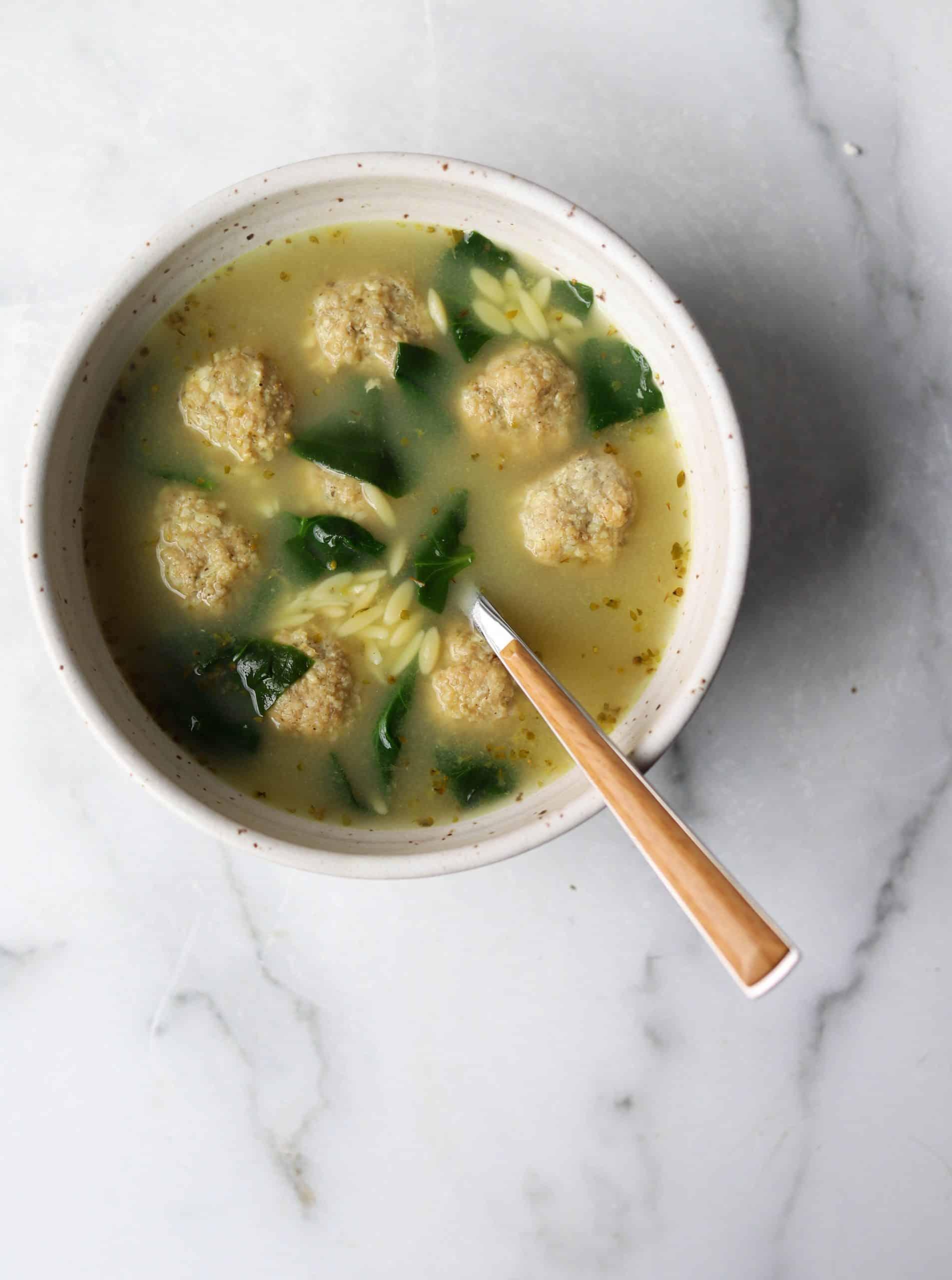 Italian wedding soup in a white pot