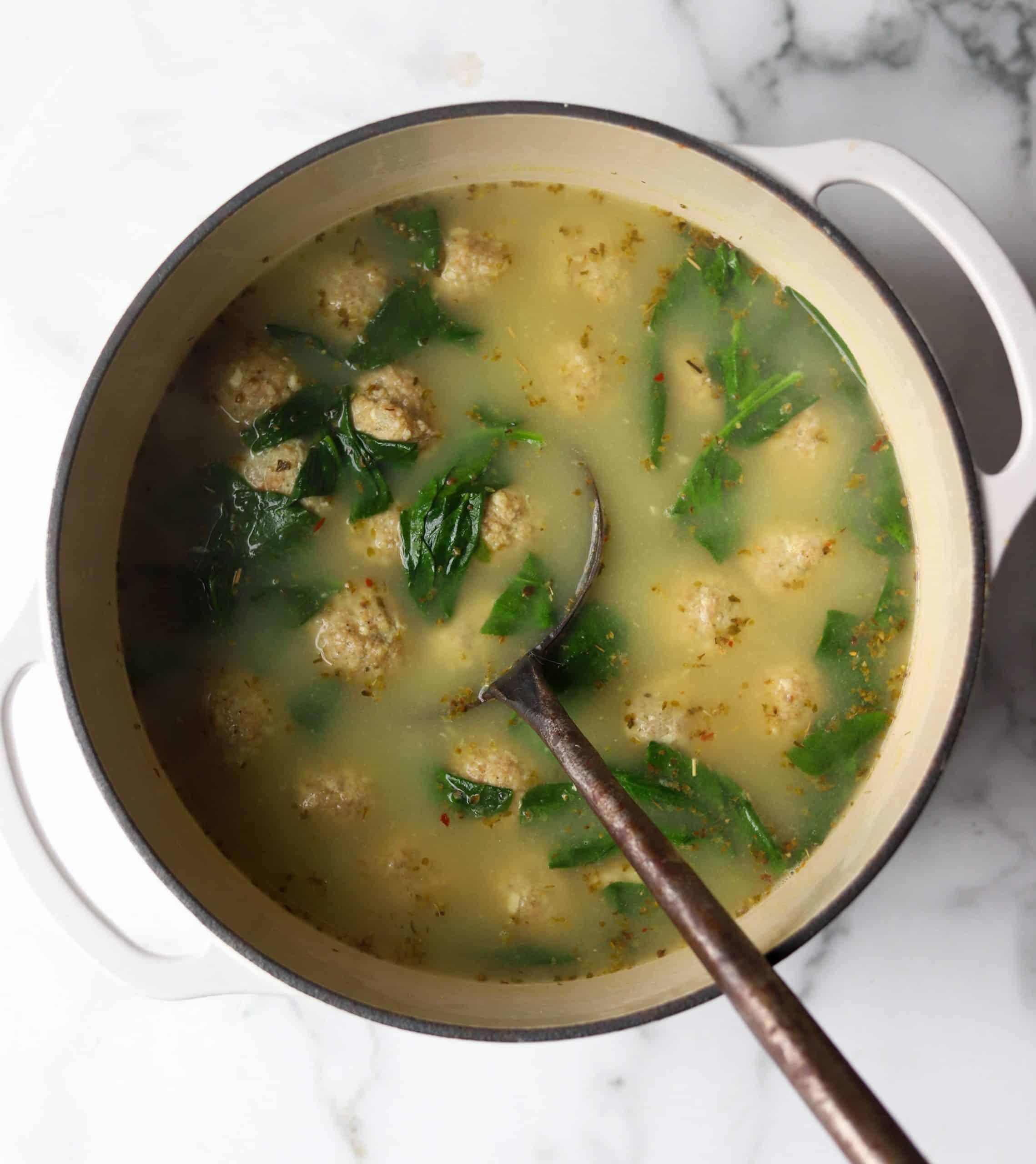 Italian wedding soup in a white bowl