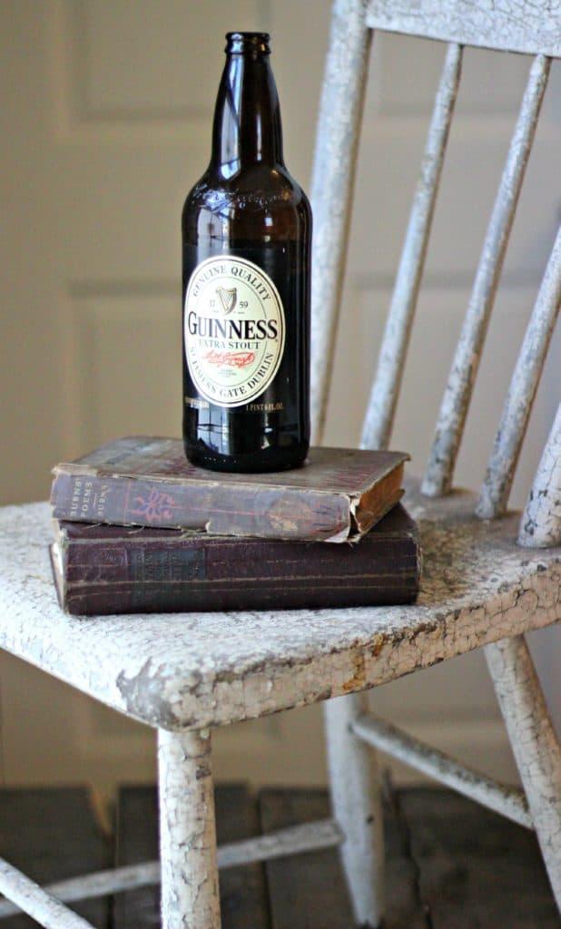 Guinness bottle on books