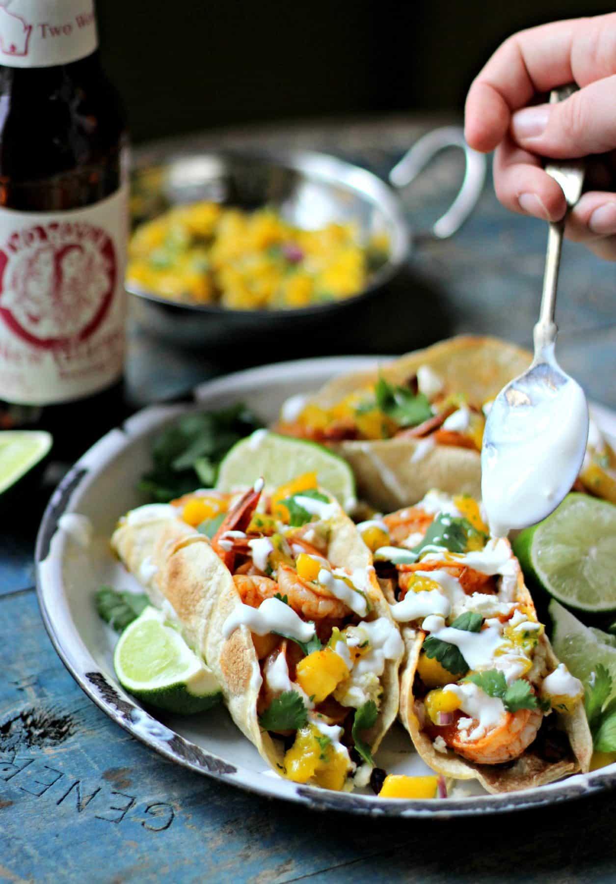 Grilled shrimp tacos on wooden backdrop