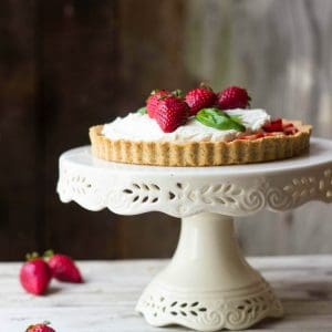 Strawberry custard tart on cake plate