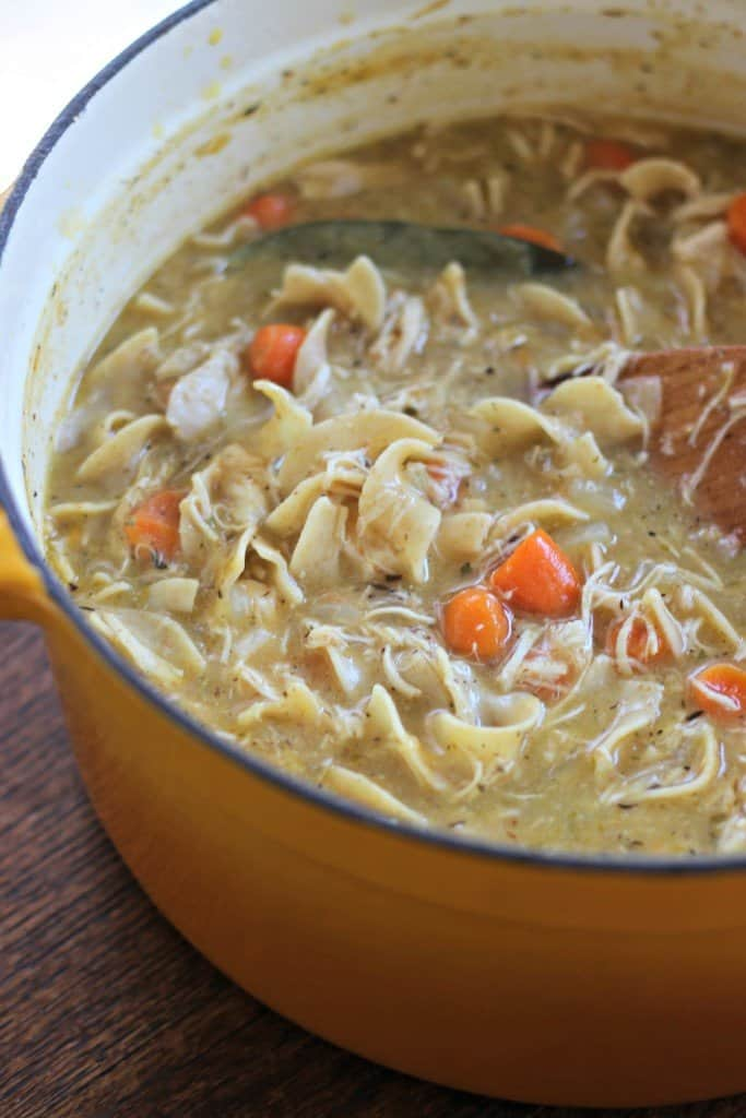 Creamy chicken noodle soup in a pot