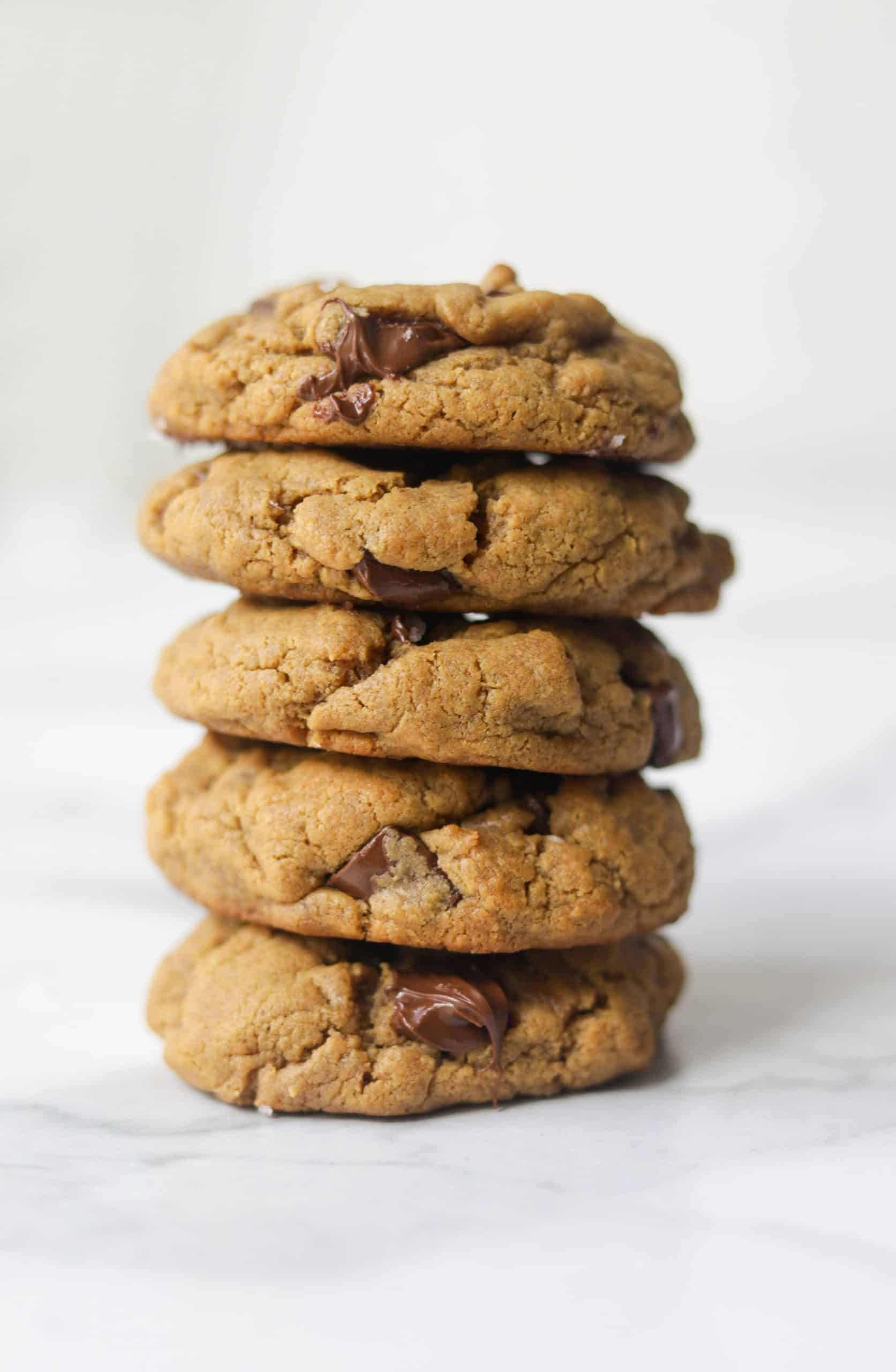 A stack of 5 peanut butter chocolate chip cookies.