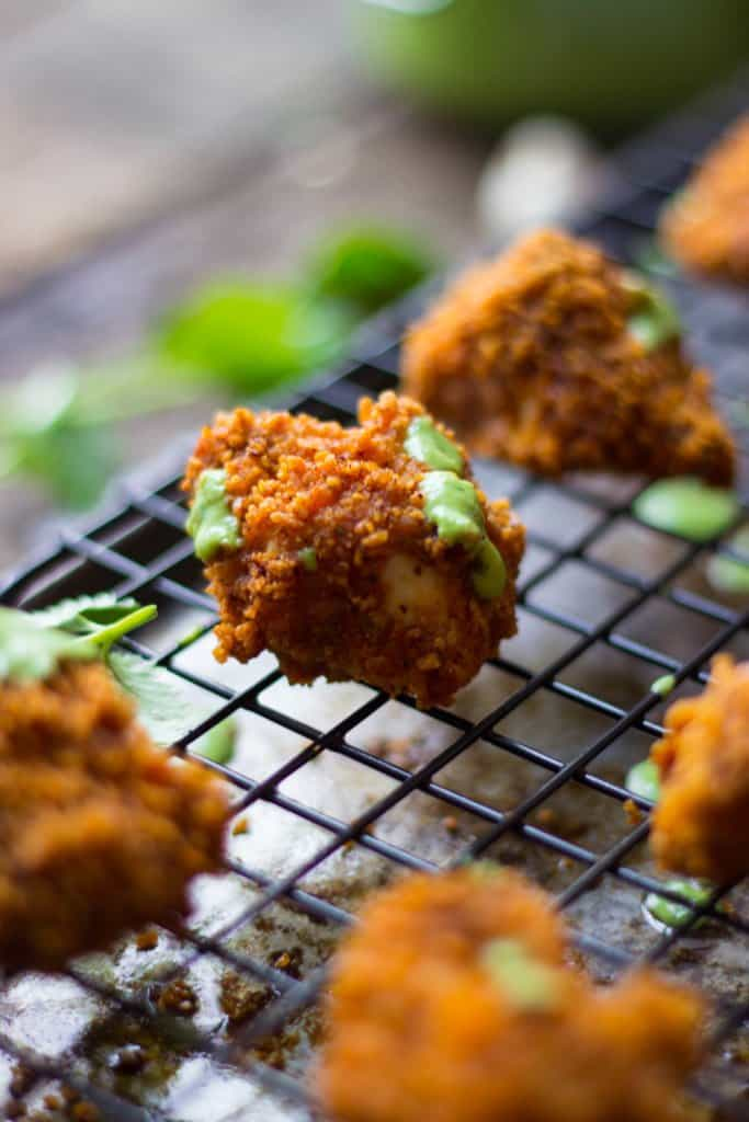 Corn chip-crusted chicken nugget on a wire rack