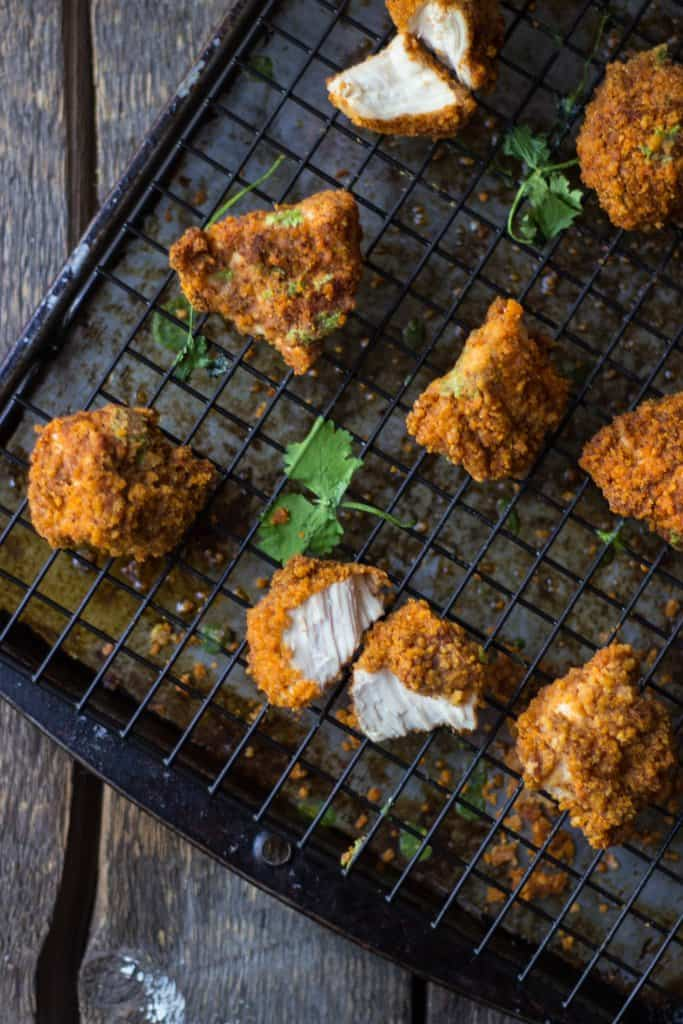 Corn chip-crusted chicken tenders on wire rack
