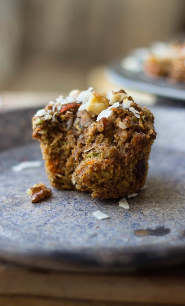 A healthy muffin recipe (morning glory) that has a bite taken out of it and shown from a side view.