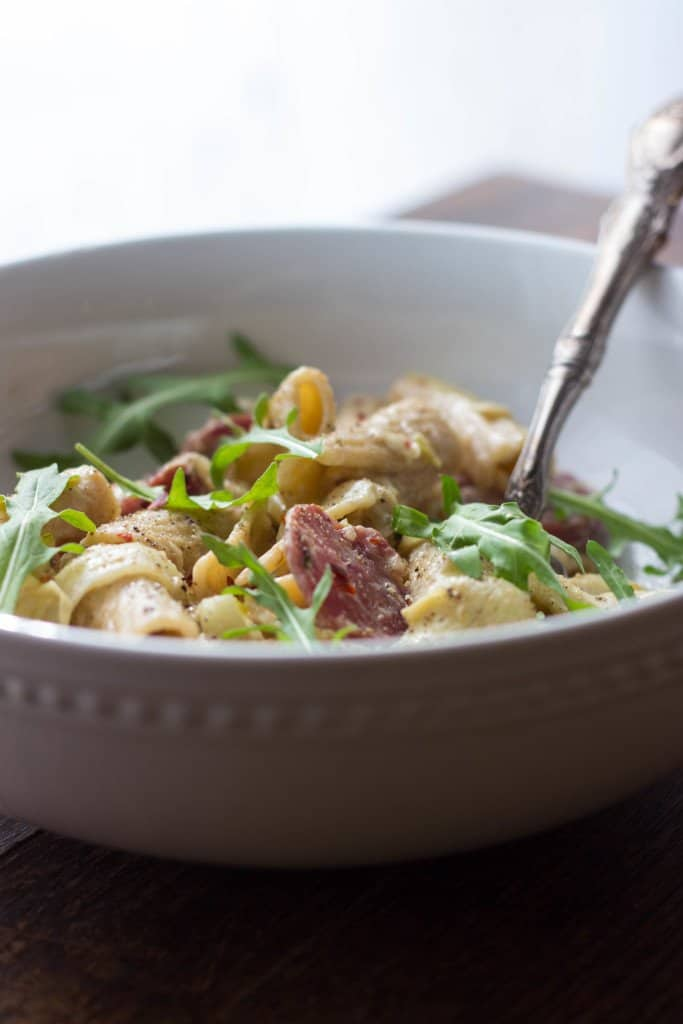 Pasta Calabrese with Artichokes in white bowl