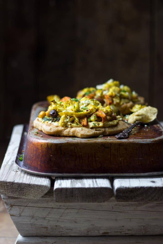 Spiced vegetable naan pizzas on a tin