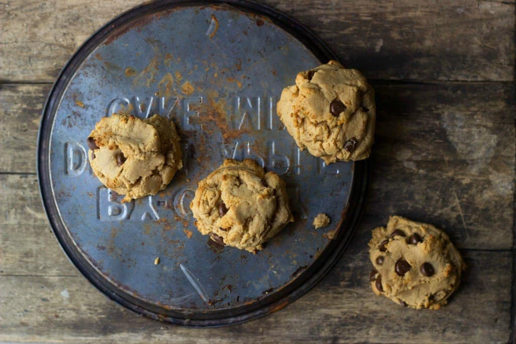 Peanut butter chocolate chip cookies on a tin