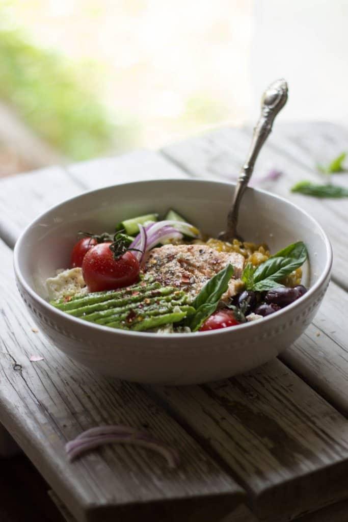 Mediterranean grain bowl in a white dish