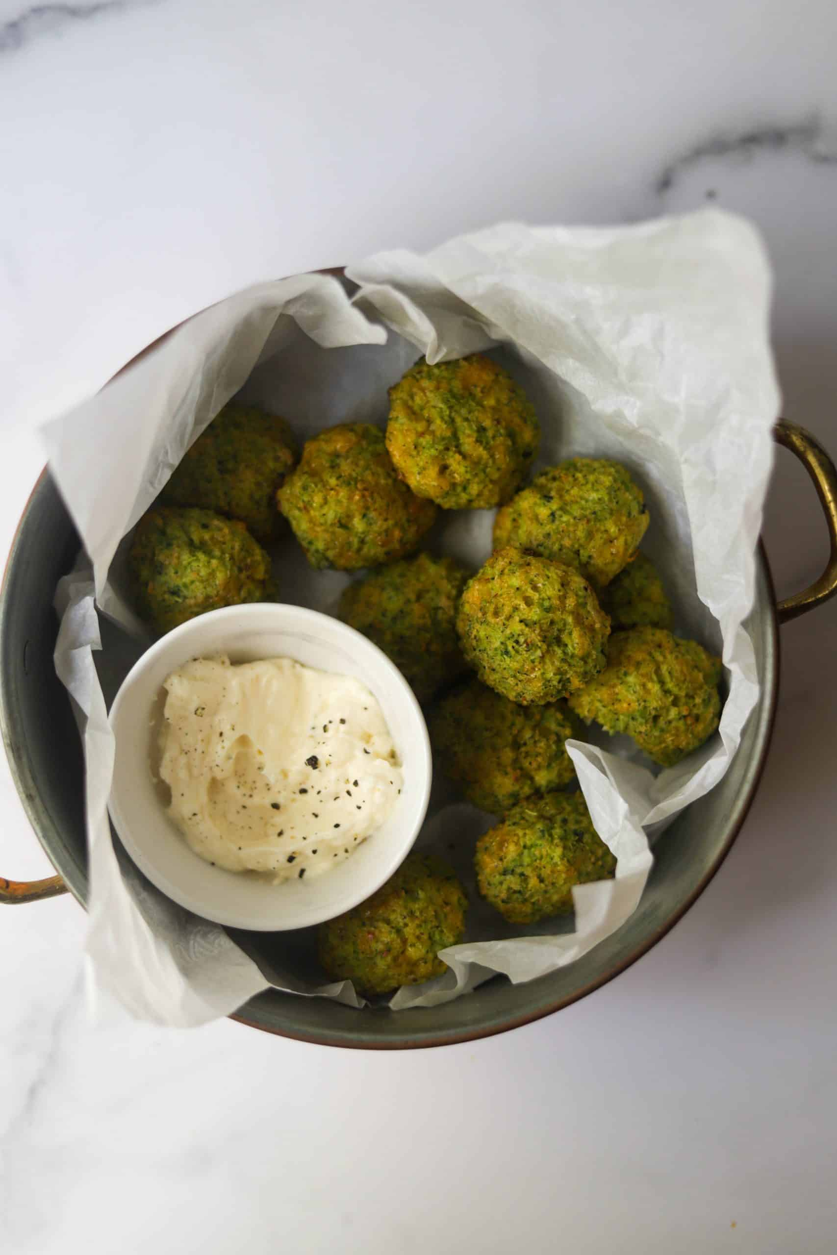 A container full of broccoli cheddar bites.