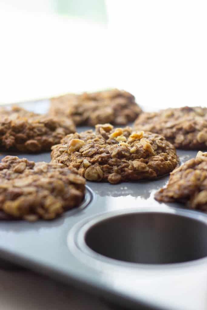 Banana crunch muffins in a tin