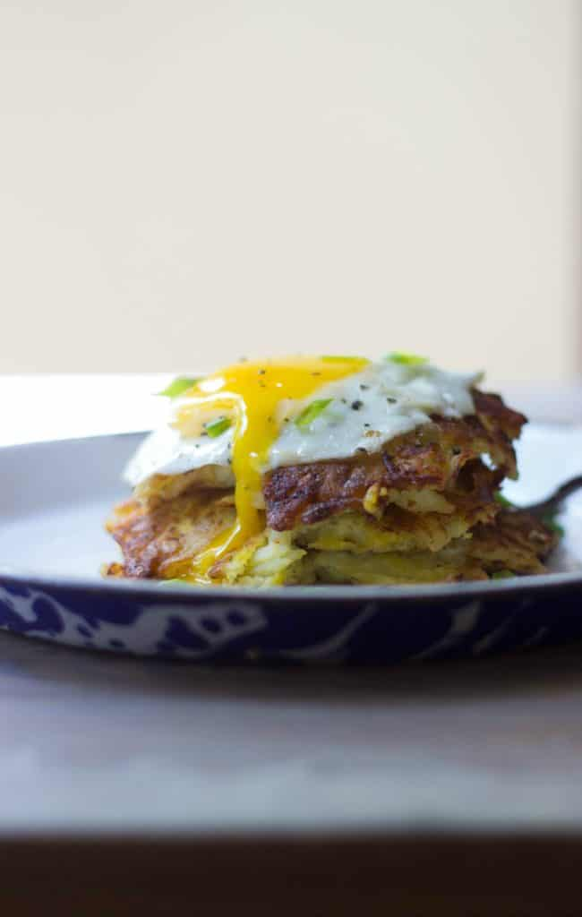 Hash brown haystacks with a fried egg on a white plate
