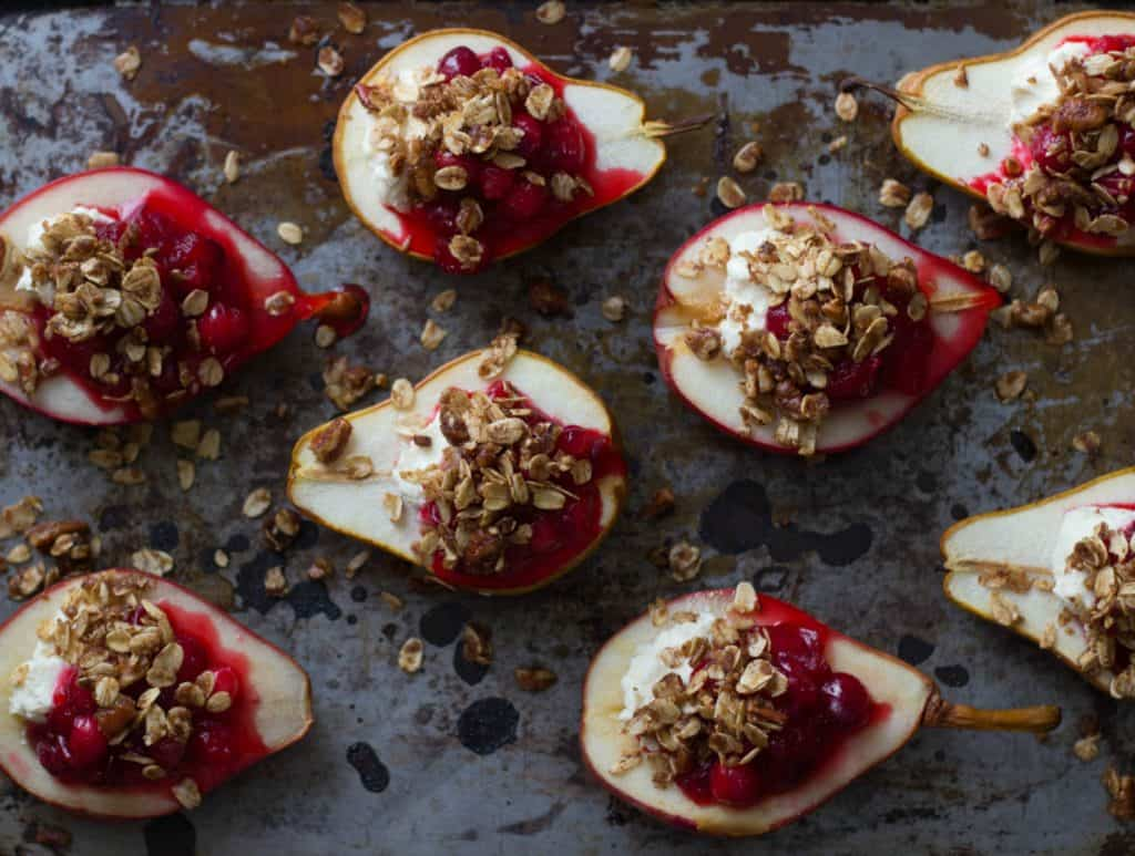 Cranberry goat cheese stuffed pears on a tray