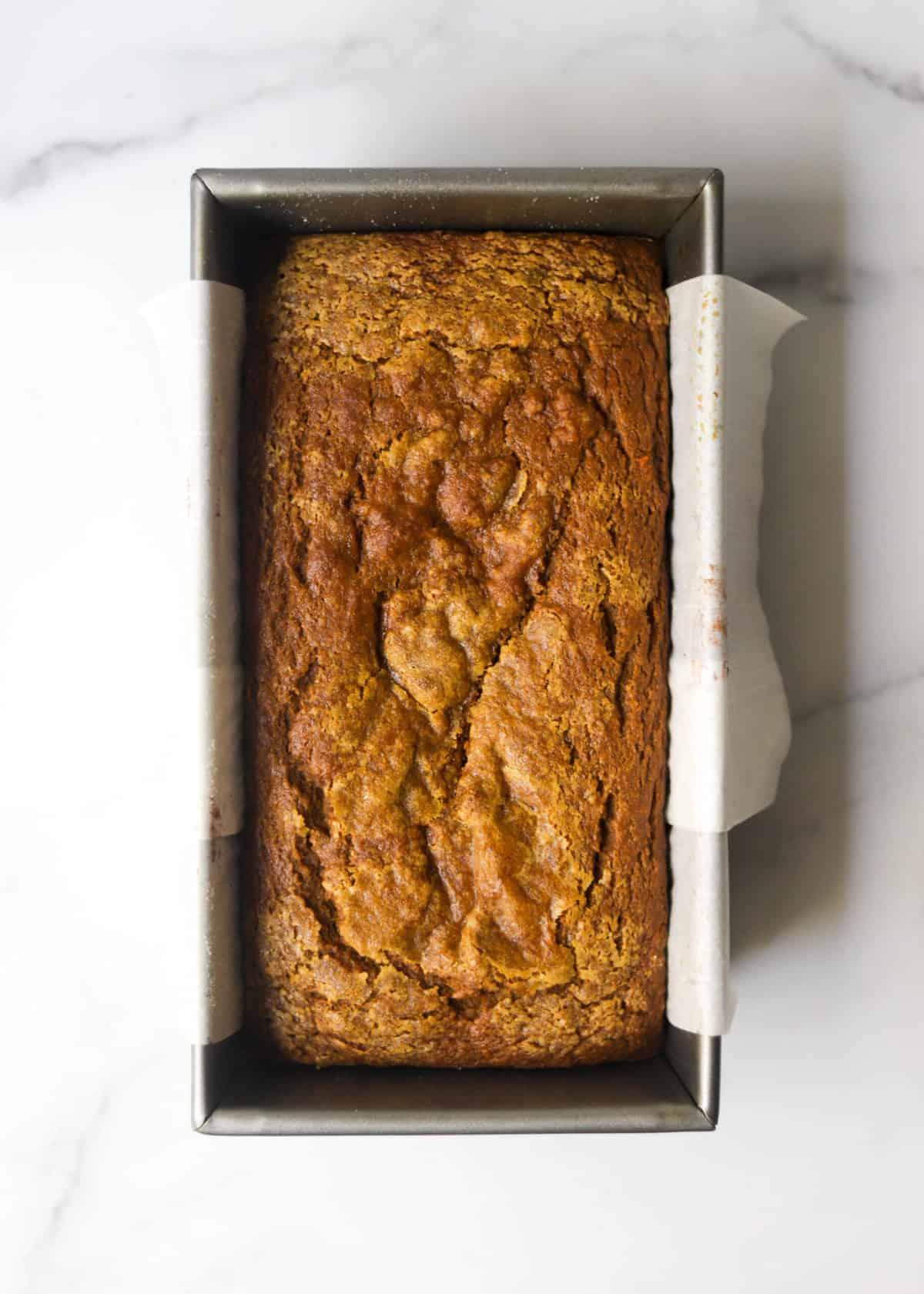 A loaf pan of pumpkin bread.