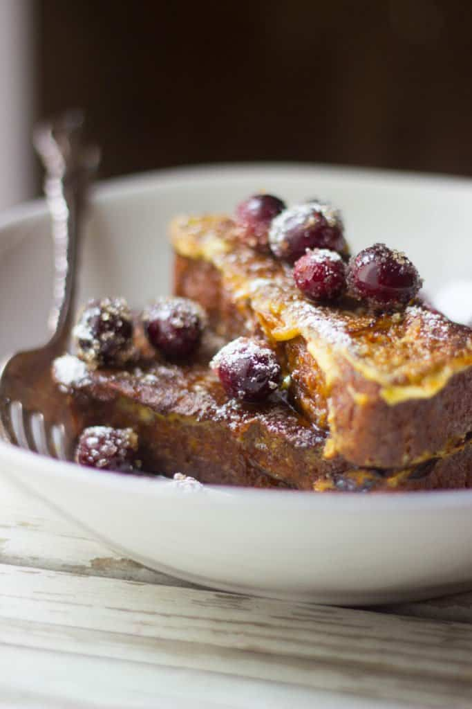 Close-up view of the french toast on a white plate.