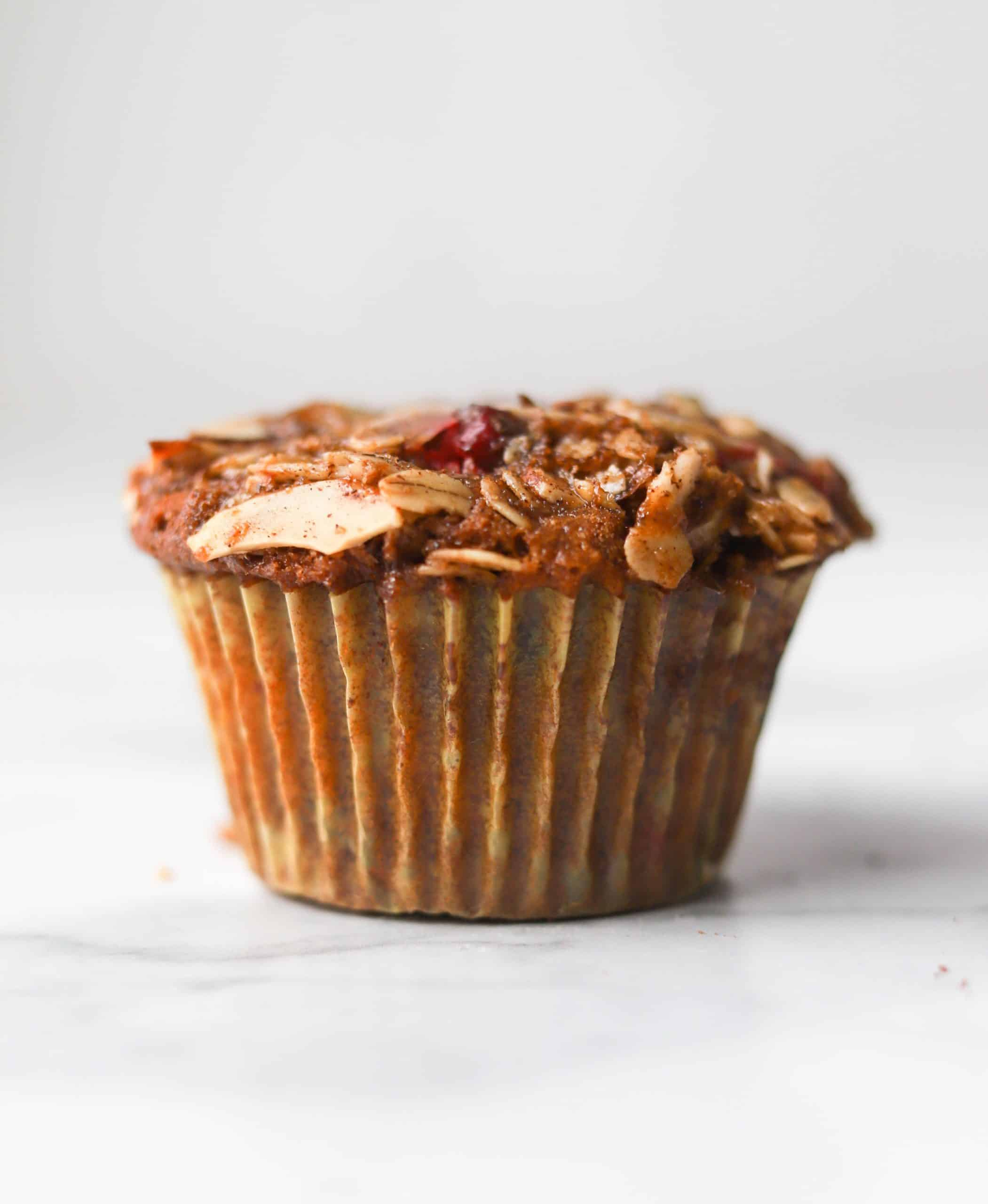 Cranberry ginger muffin on marble board