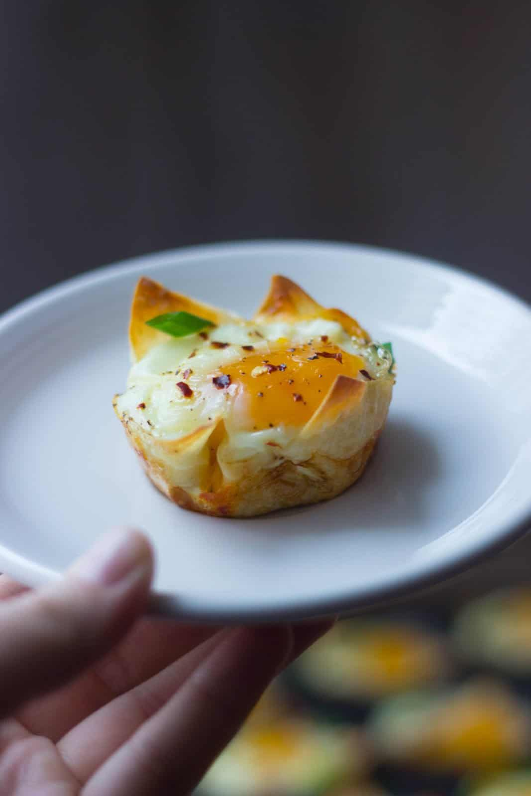 Cheesy Wonton Breakfast Cup on a white plate.
