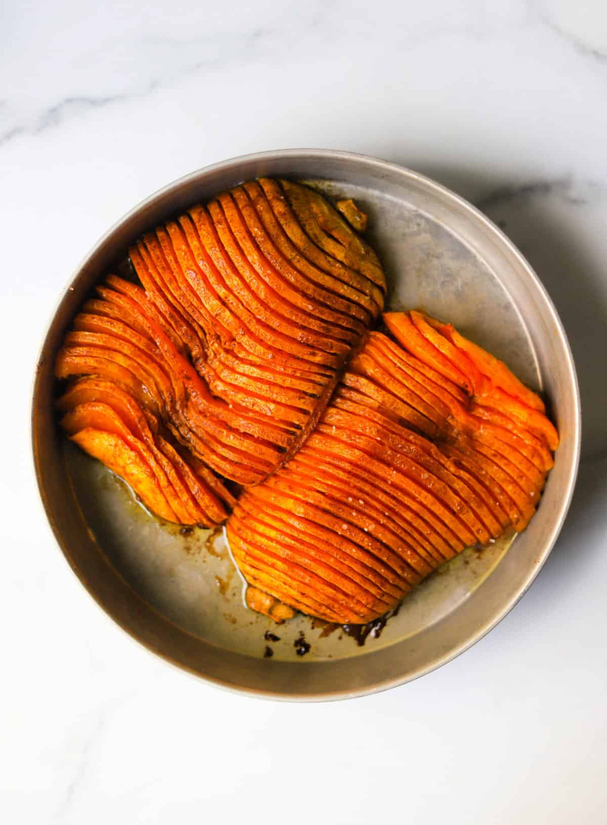 An overhead shot of a tray with hasselback butternut squash.