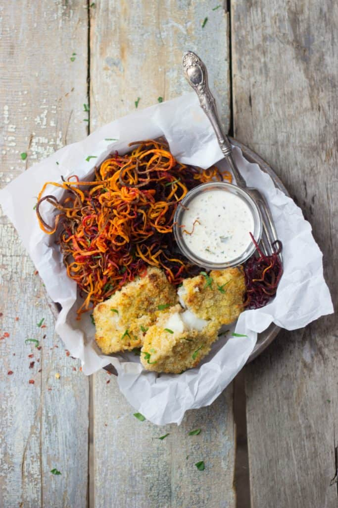 Crispy baked fish with sweet potato curly fries in a tin