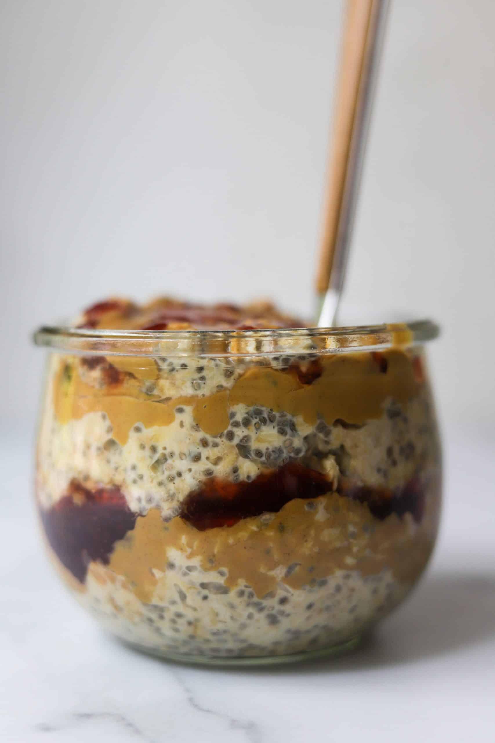 A side shot of a jar of PB and J oats.