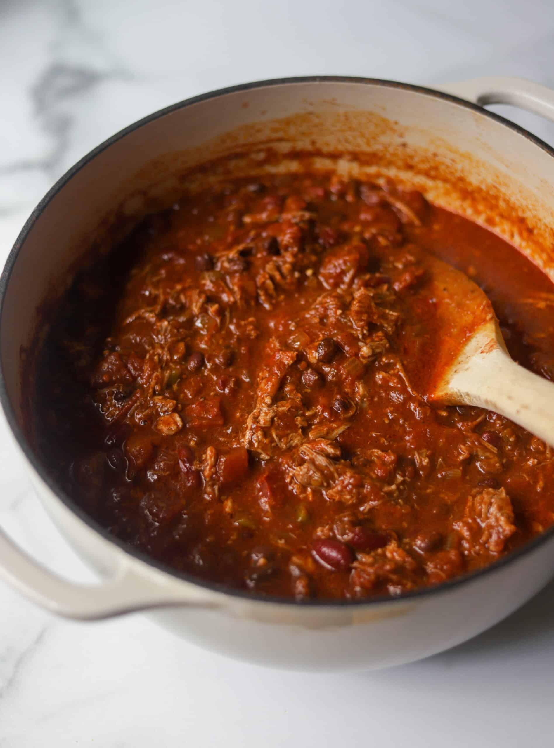 A big pot of pulled pork chili.