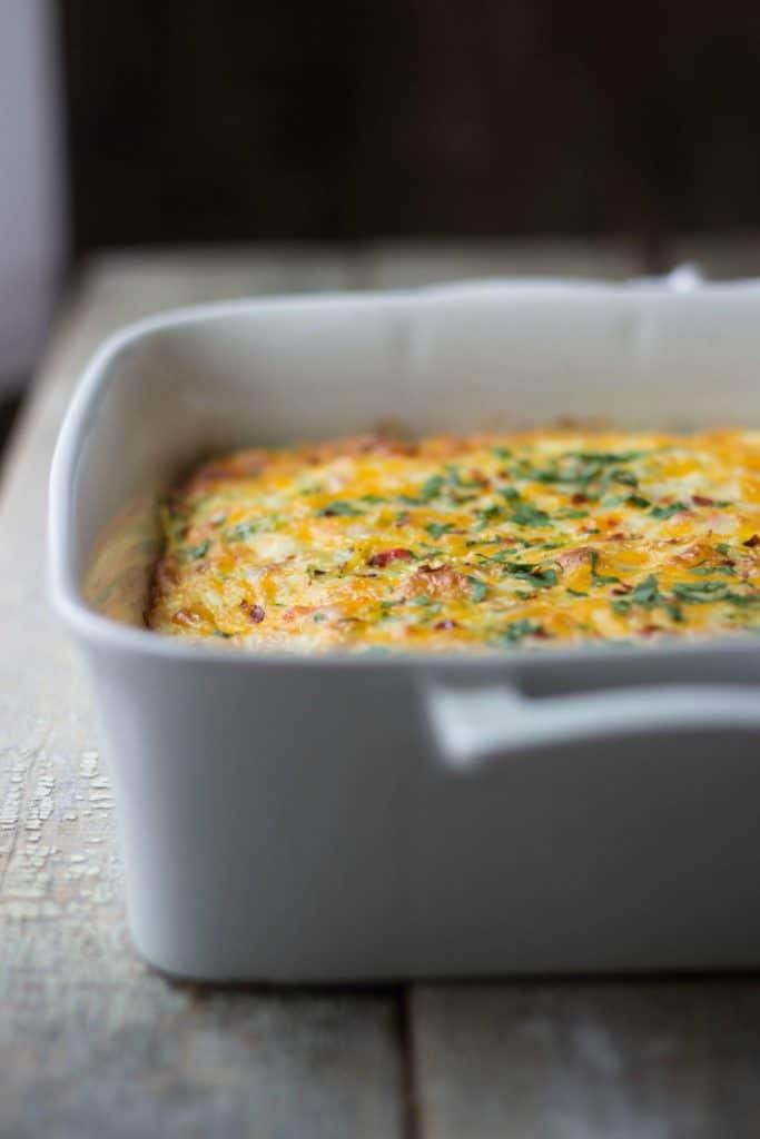 Breakfast casserole in a white casserole dish