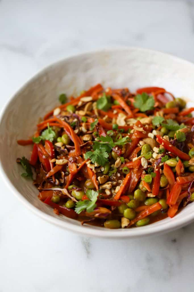 Thai vegetable salad in a white bowl