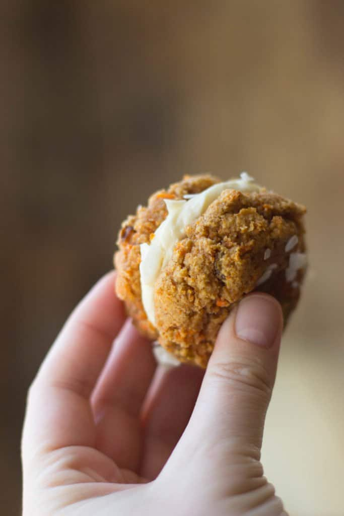 Carrot cake cookie sandwich in a hand