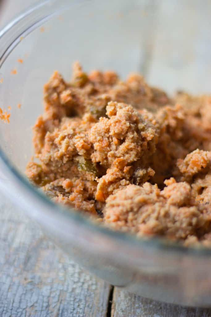 Carrot cake batter in a clear bowl