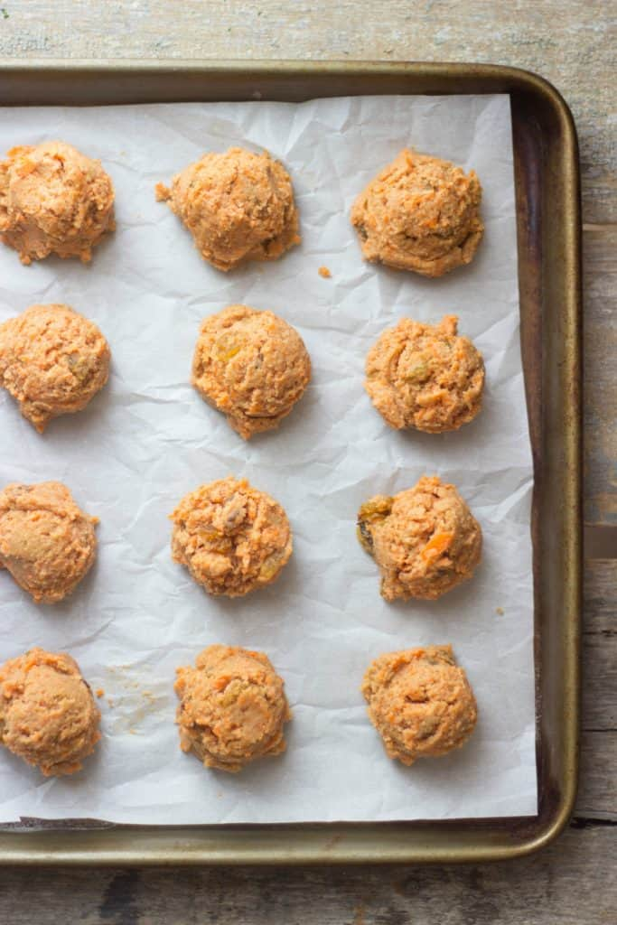 Carrot cake cookie sandwiches on a tin
