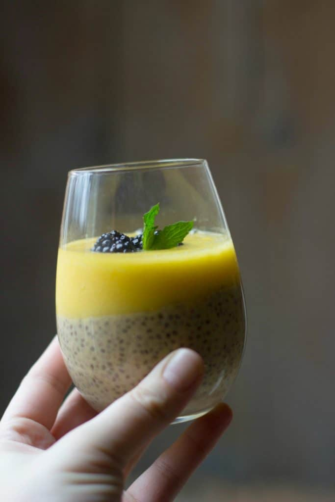 Mango chia pudding in a clear glass