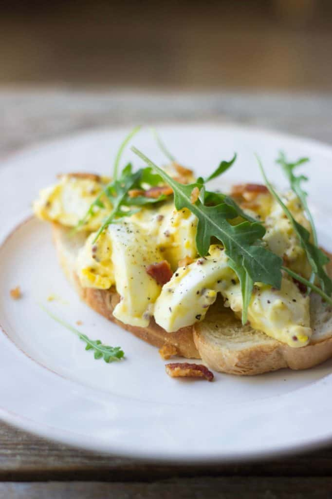 Egg salad sandwich on a white plate