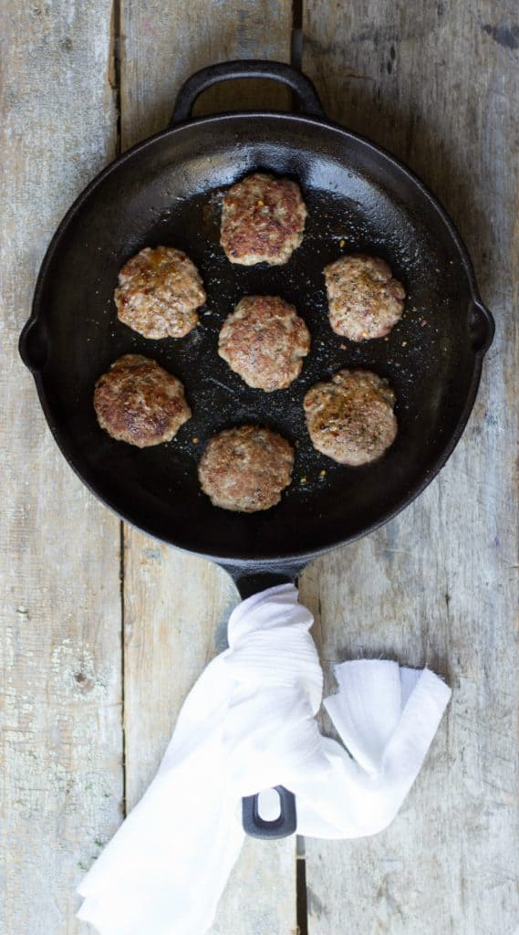 Sausage patties in a cast iron skillet