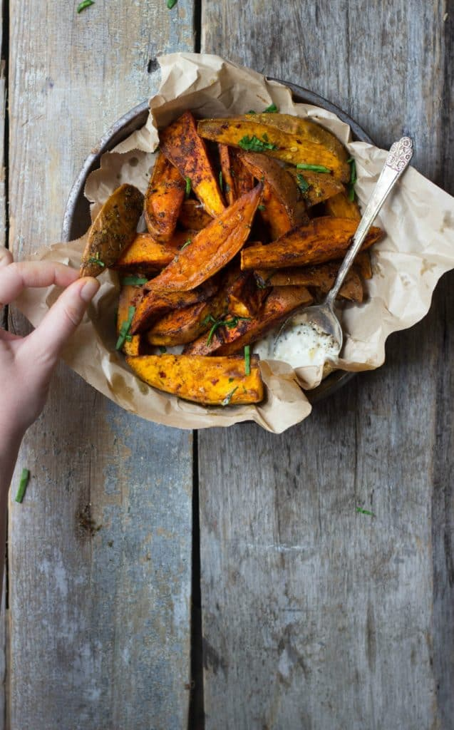 Roasted sweet potato wedges in a tin