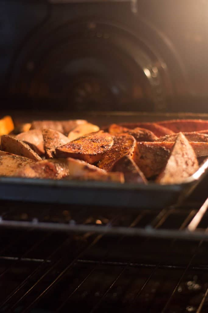 Roasted sweet potato wedges cooking in the oven