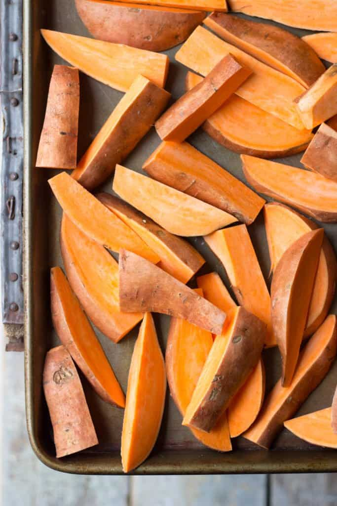 Sweet potato wedges on a baking sheet