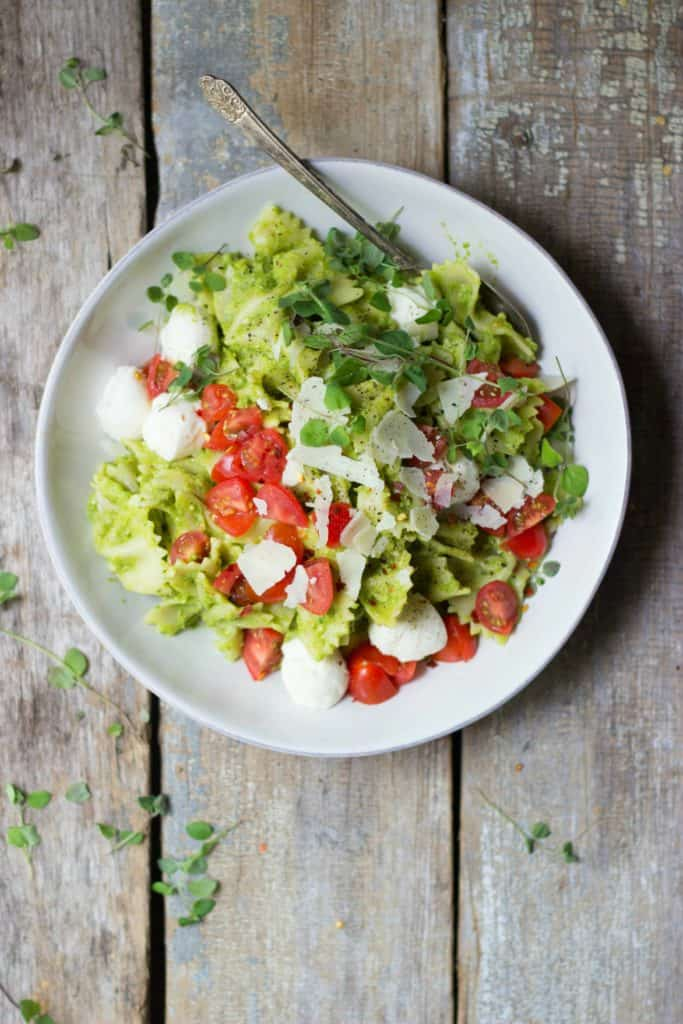 Caprese pasta salad in a white bowl