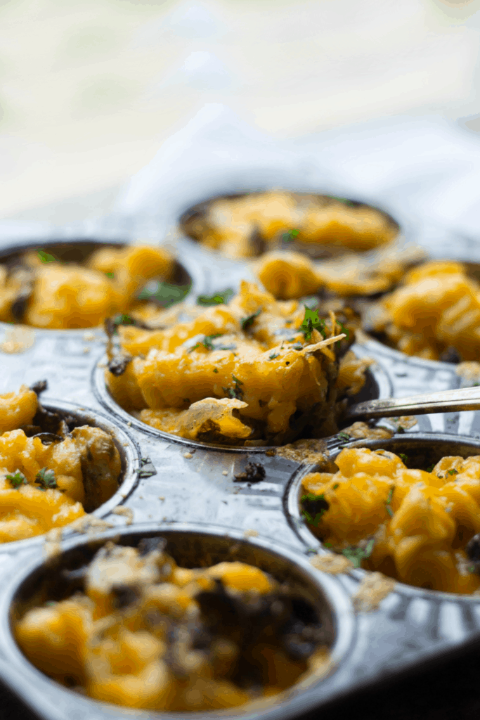 Close-up of mac and cheese cups in a tin