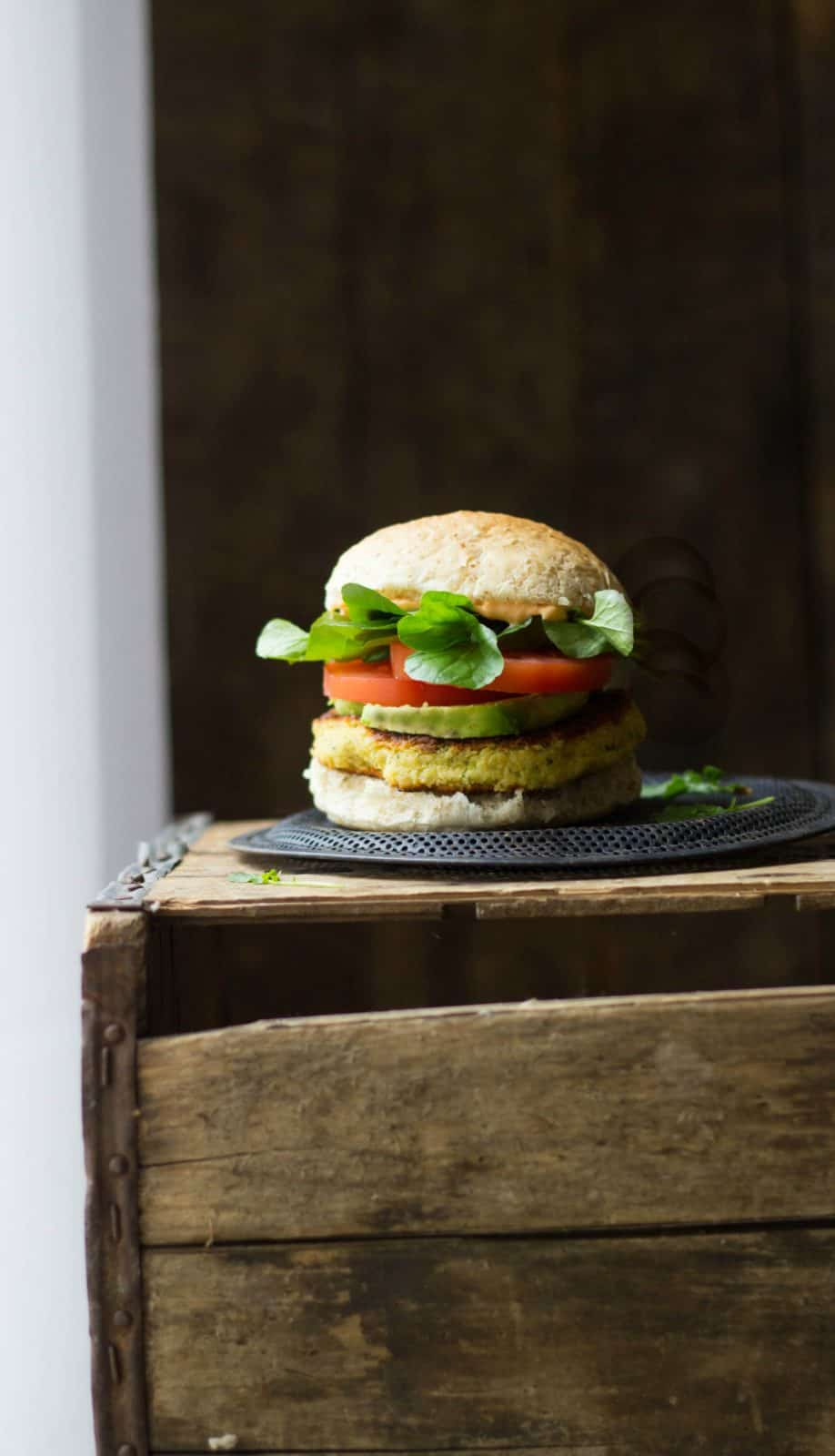 Veggie burgers on a crate.