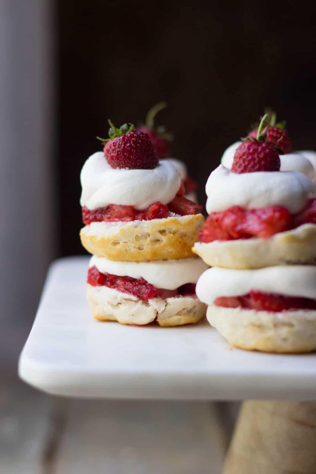Close up side shot of mini strawberry shortcake stacks on a cake stand