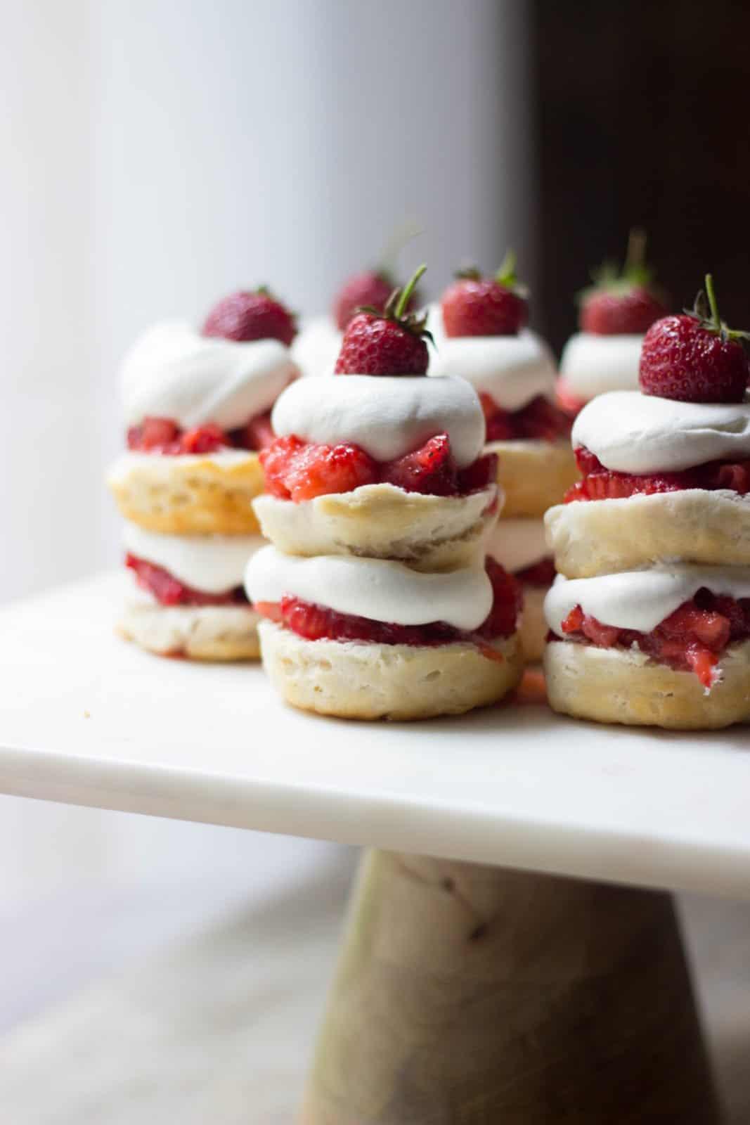 Close up shot of mini strawberry shortcake stacks on a cake stand