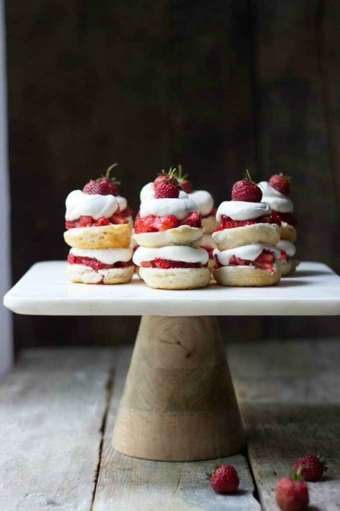 Mini strawberry shortcake stacks on a cake stand