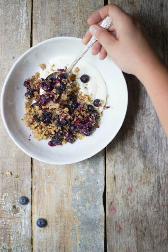 Blueberry quinoa crumble in a white bowl