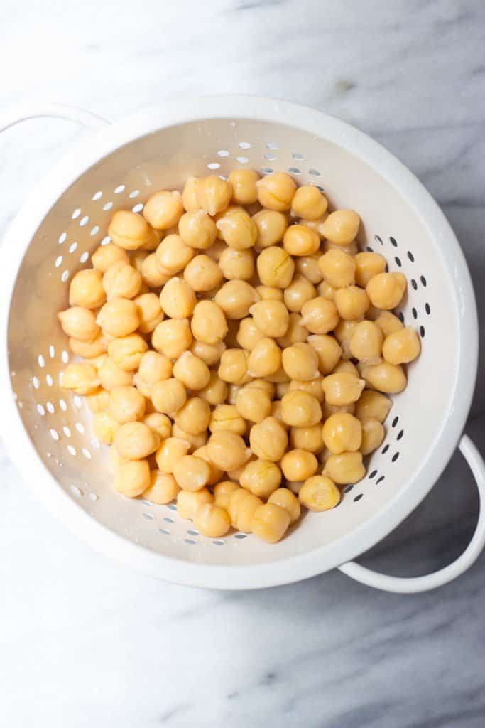 Chickpeas in a white strainer