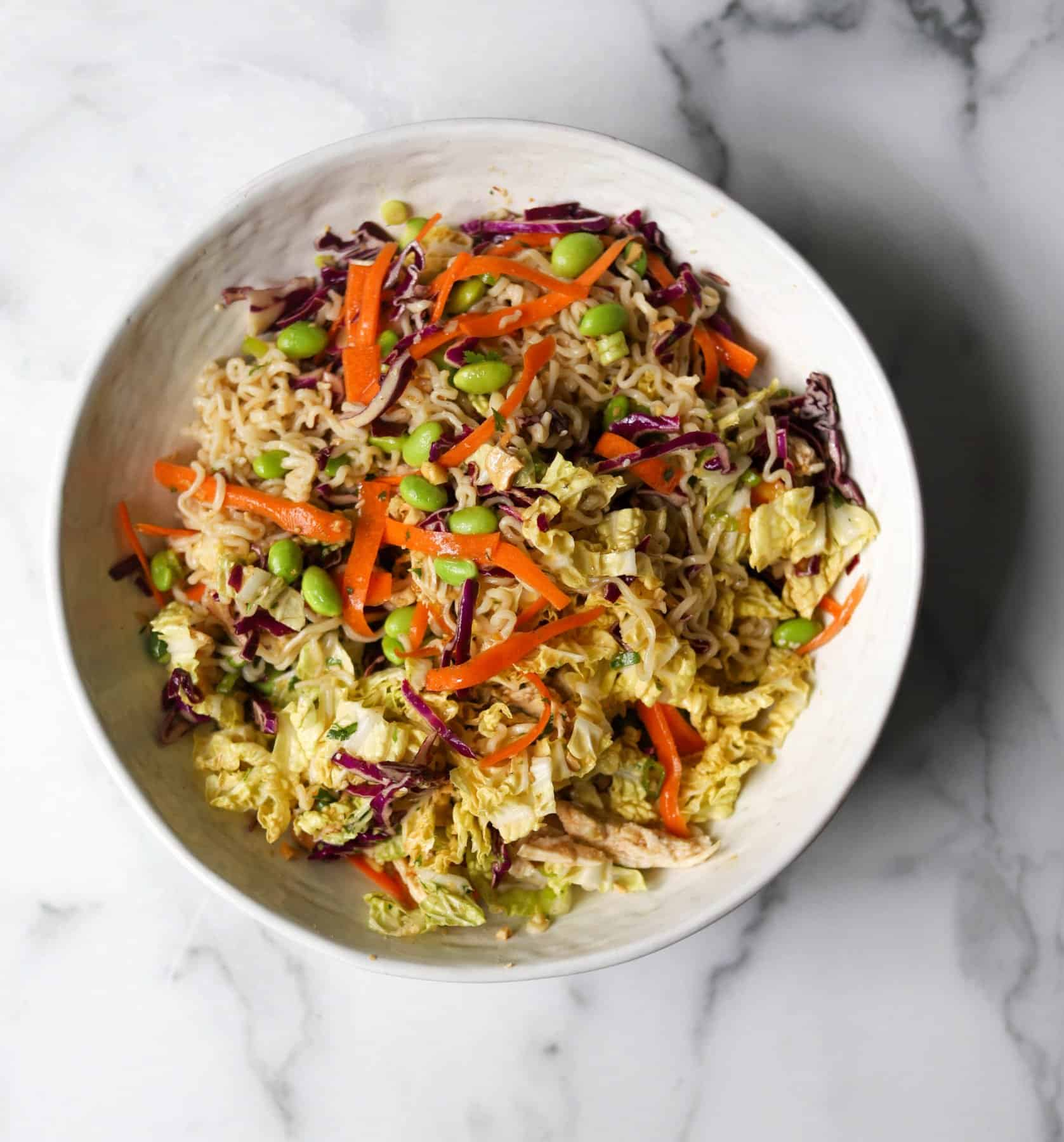 Chinese chicken salad in a white bowl