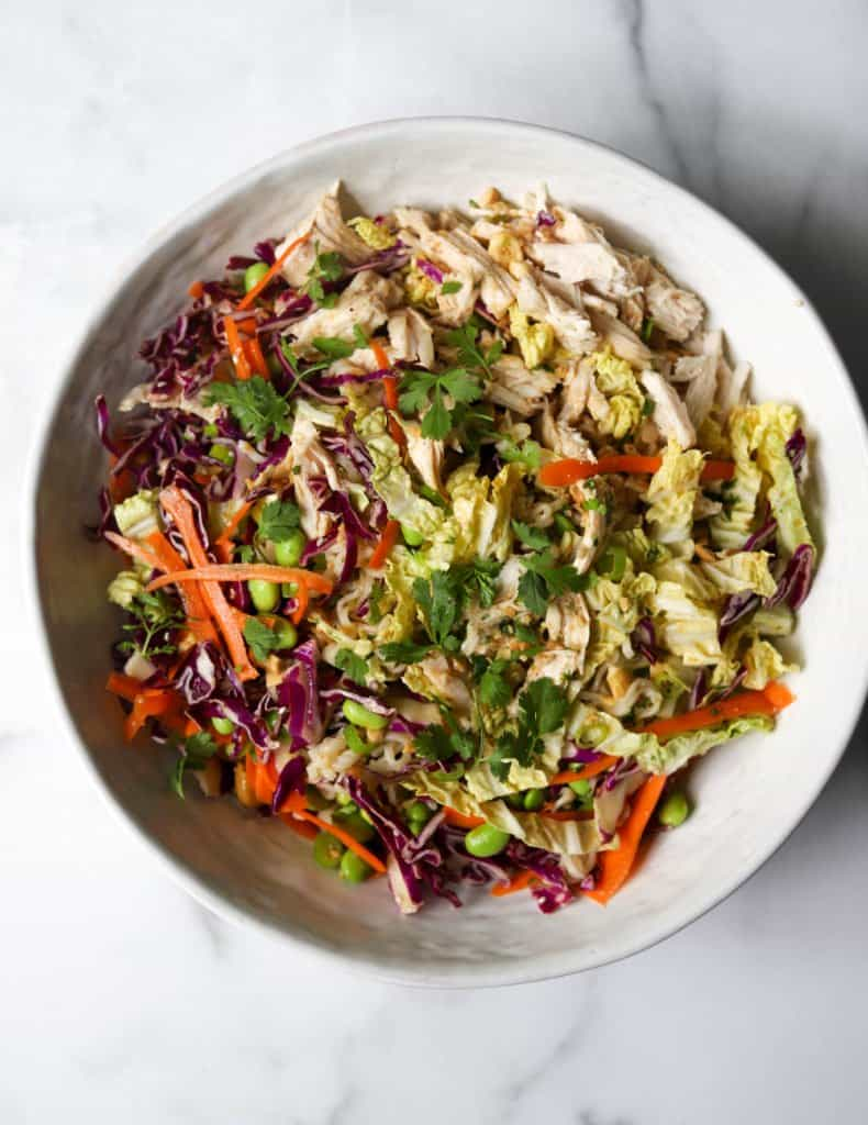 Overhead shot of Chinese chicken salad in a white bowl