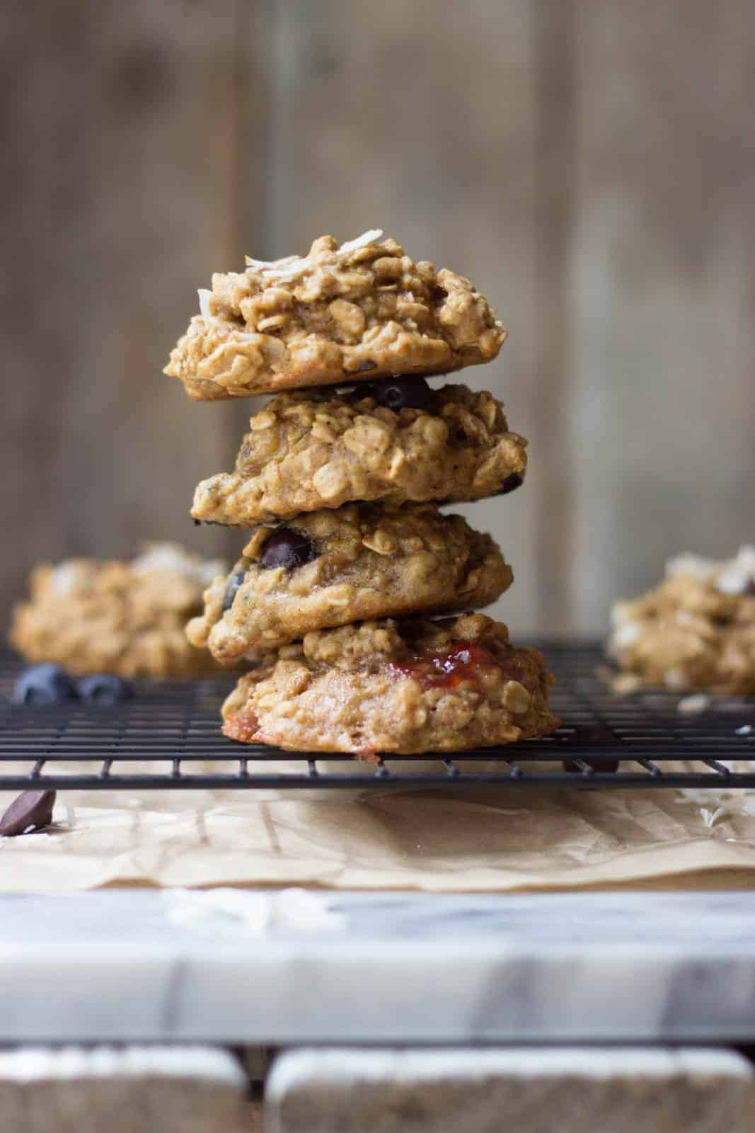 Side shot of stacked breakfast cookies on a wire rack.