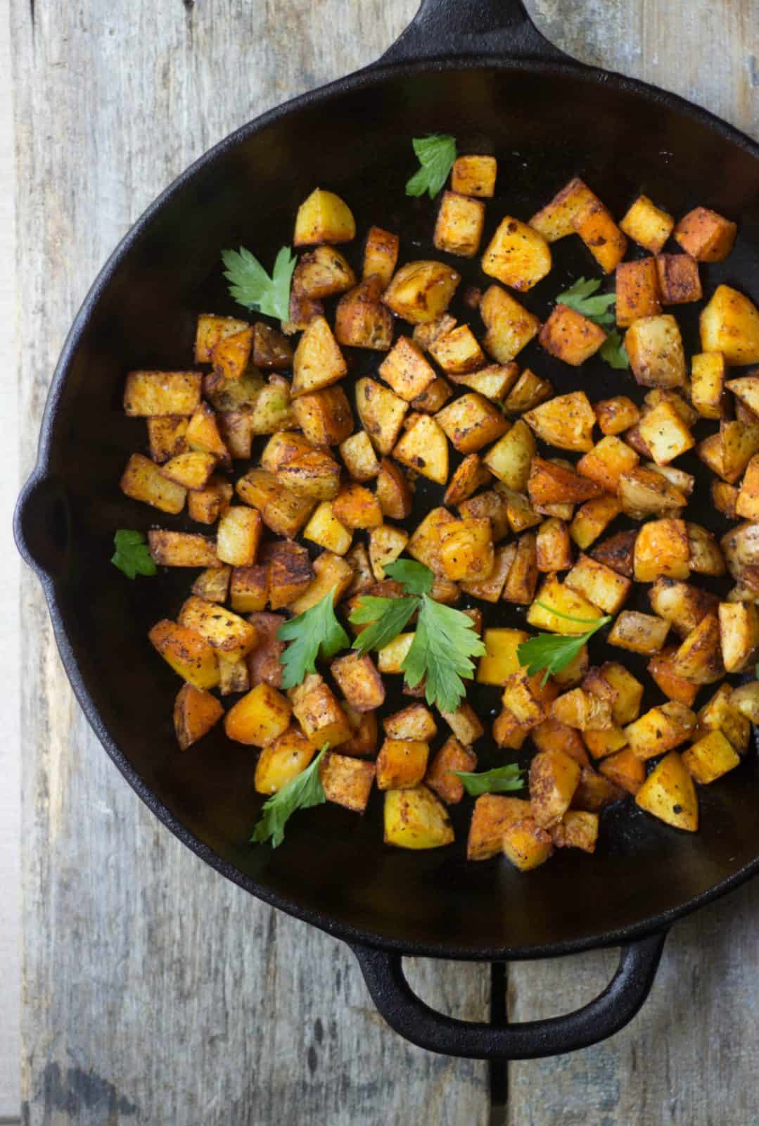 Crispy Breakfast Potatoes in a cast iron skillet as a healthy recipe for beginner cooks.